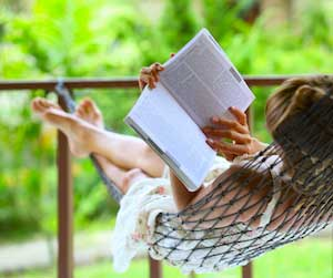 Person reading in a hammock image