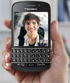 hand holding a blackberry 10 image