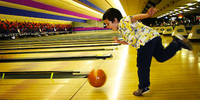 Kid playing bowling image